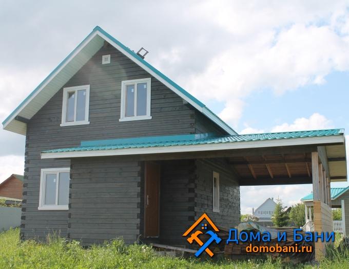 фото деревянного дома с навесом